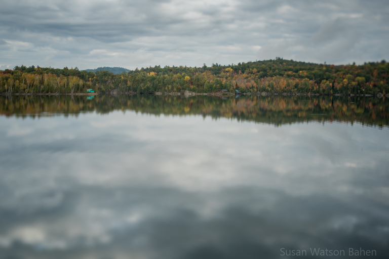 A pretty landscape image of a cloudy sky reflected in a very still Lake Pemichangan, Quebec shot with Lensbaby Edge 50 by Susan Bahen Photography, Ottawa Fine Art Photographer.