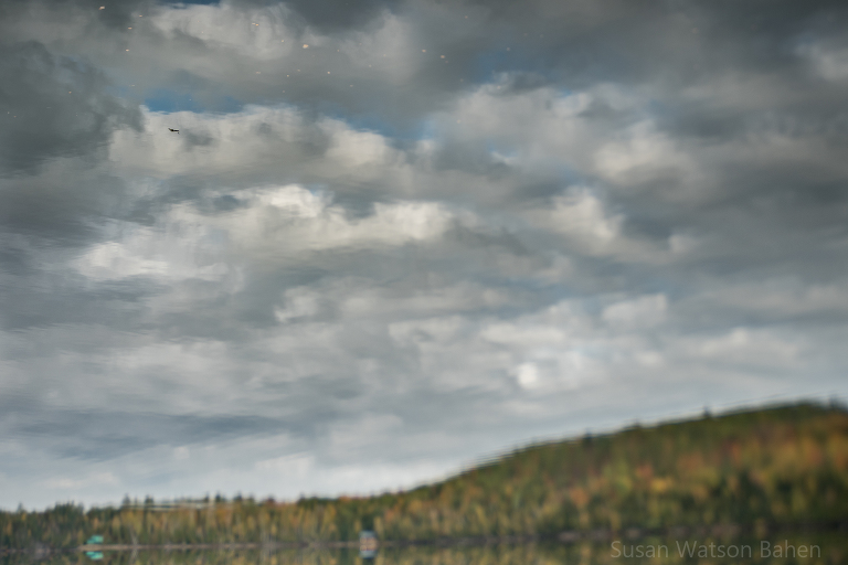 A reflection of a cloudy sky in Lake Pemichangan by Ottawa Fine Art Photographer, Susan Watson Bahen